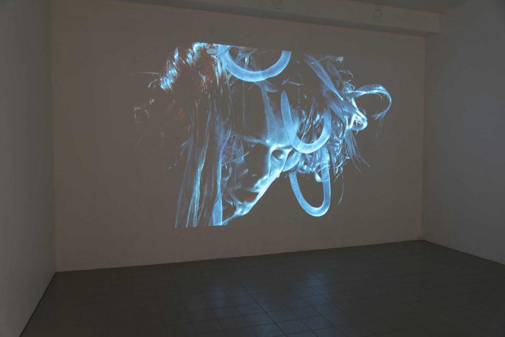 Blue wall projection,Head On My Dear - Helene Nymann